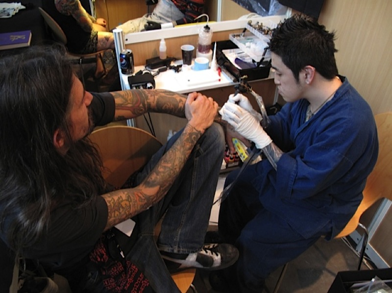Horiyoshi III´s son`Kazuyoshi` tattooing Filip Leu at the Mondial du Tatouage 2013